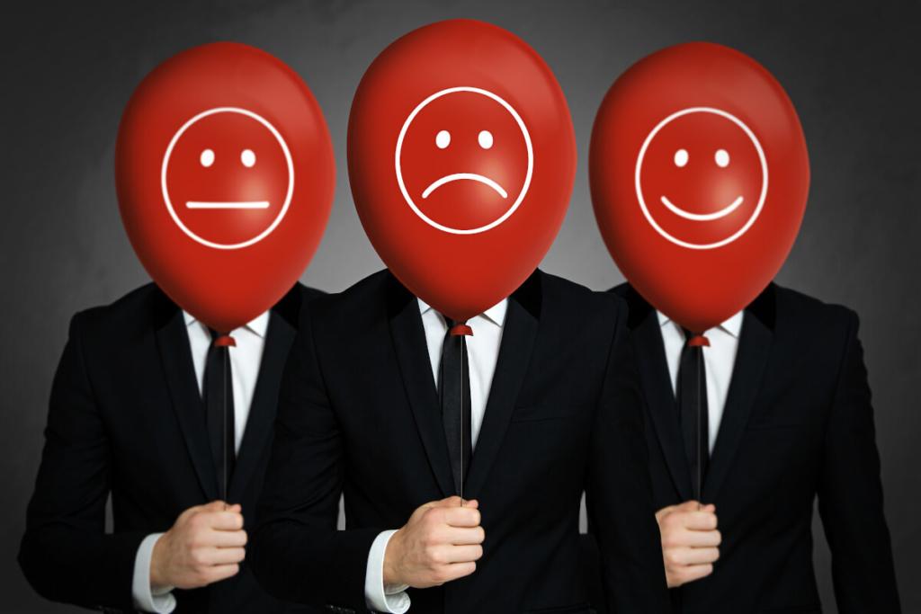 Drei Angestellte zeigen Zufriedenheit und Unzufriedenheit auf einem Ballon